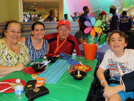 A family dines during Family Fun Night at Children's
