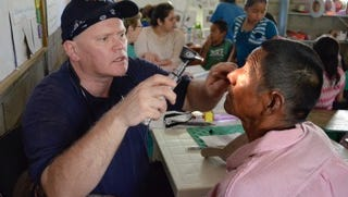 Dr. Richard Thacker with patient