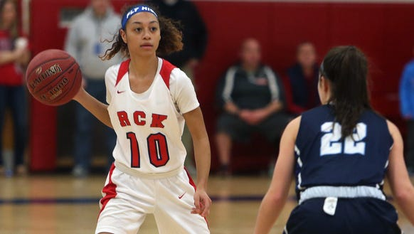 From left, R.C Ketcham's Mya Smith looks to get around