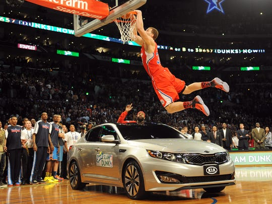 Blake Griffin dunks over a car with teammate Baron