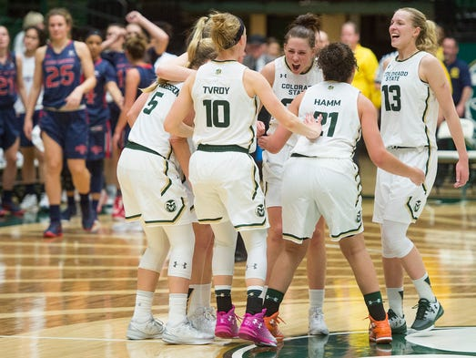CSU celebrates an 80-68 win in overtime against Saint