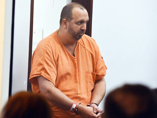 Craig Hicks enters the courtroom for his first appearance