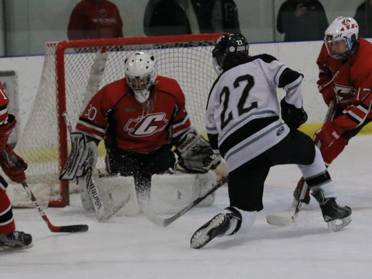 Going hard to the net Wednesday is Plymouth's Jake Silvester. In net for the Canton Chiefs is senior Isaac Salinas.