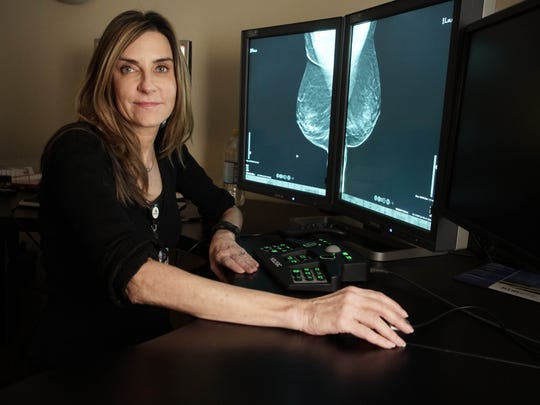 Dr. Jacqueline Holt, a radiologist and director of breast imaging at the Helen F. Graham Cancer Center & Research Institute, reads the 3-D imaging from a tomosynthesis mammography machine made by Hologic, a pioneer in the rapidly advancing technology.