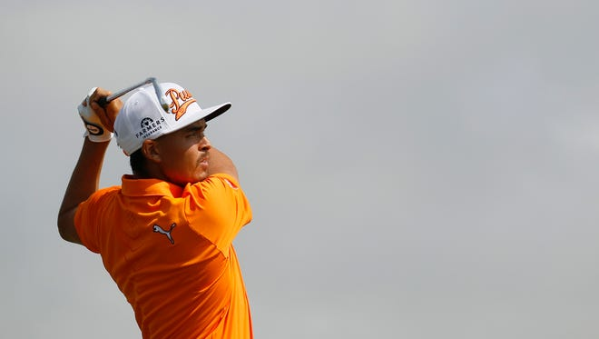 Rickie Fowler plays a shot off the 6th tee during the final round of the British Open Golf championship at the Royal Liverpool golf club, Hoylake, England, Sunday July 20, 2014. (AP Photo/Peter Morrison)