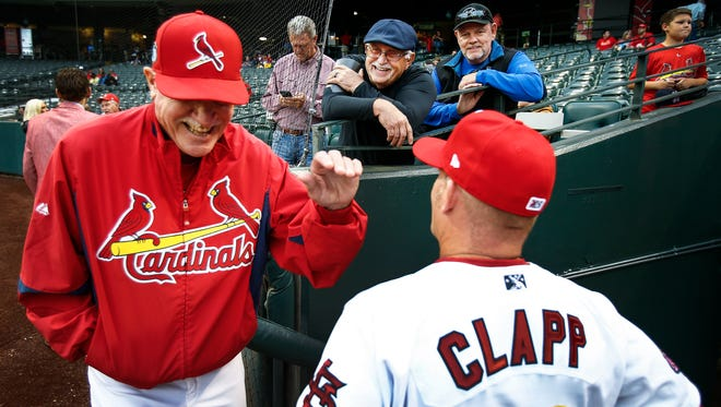Former Memphis Redbirds standout and new manager Stubby Clapp (bottom right) jokes with former manager Gaylen Pitts (left) and fans Bob Durr (top left) and Harvey Hughes (top right)  before the team's home opener at AutoZone Park, Tuesday night.