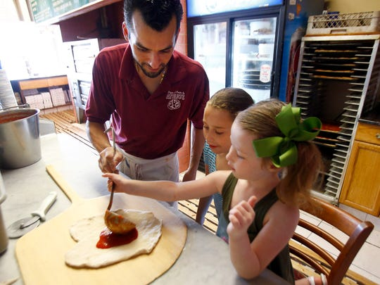 Kevin Durazzo prepares a pizza with his nieces Samantha, 9, and Breanna Durazzo, Barnegat, at Attilio's Restaurant & Pizzeria in Freehold Township.