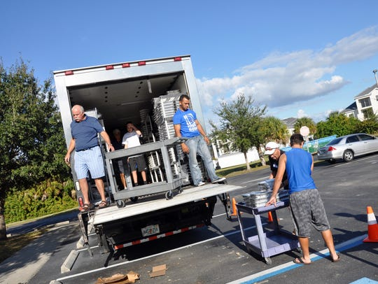 Volunteers load a refrigerated truck with Thanksgiving