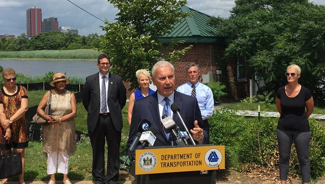 Wilmington Mayor Mike Purzycki speaks on Friday at a groundbreaking event for a new bridge across the Christina River. The  bridge will tie together the economies of the Riverfront and Southbridge, he said.