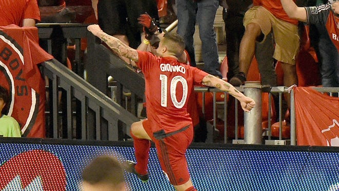 Toronto FC forward Sebastian Giovinco leaps in celebration after scoring against Orlando FC in the second half of a win at BMO Field.