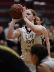 Jessica Winders of Webster County shoots a free throw to take the lead late in the second quarter against Daviess County during the game in Dixon Thursday.