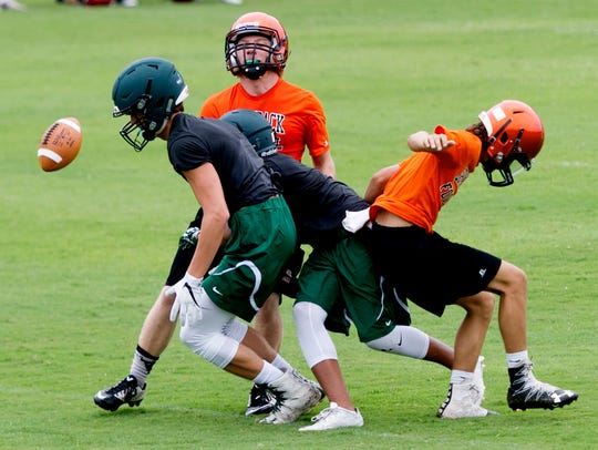 Greenback (orange) and Webb (green) play at the East