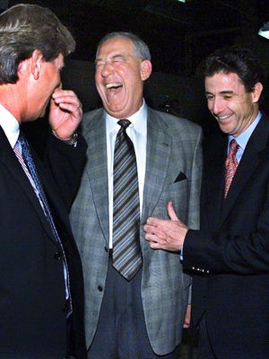 -  -Caption:   BY STEWART BOWMAN, THE COURIER-JOURNAL Retiring UK athletic director C.M. Newton, center, shared a laugh with football coach Hal Mumme, left, and former Wildcats basketball coach Rick Pitino at last night's tribute dinner in Rupp Arena.