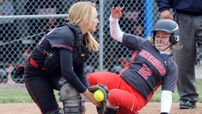 Sheridan's Sara Cooper slides safely into home past Circleville's Angyl Mellon during the Generals' 11-0 sectional finals win over the Tigers on Saturday in Circleville. Sheridan will meet Waverly in the Division II district semifinals on Monday in Athens.