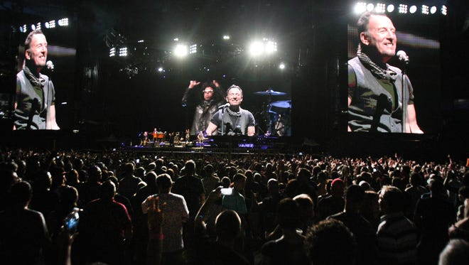 Bruce Springsteen towers over the audience as he performs with the E Street Band at MetLife Stadium in East Rutherford, NJ, Tuesday, Aug. 23.