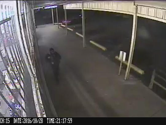 Armed robbery suspect is seen on surveillance camera at Family Dollar.