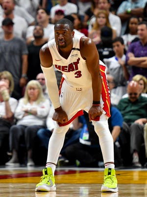 Miami Heat guard Dwyane Wade guards the back court during the second half against the Philadelphia 76ers.
