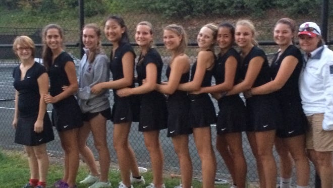 Adrienne Haynes, fifth from the right, and the rest of the Asheville High girls tennis team.