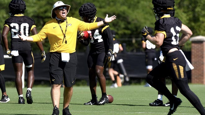 Missouri head football coach Eli Drinkwitz shouts directions to players during the first day of fall practice Monday at the Kadlec Practice Fields. The Tigers are scheduled to open their season Sept. 26.