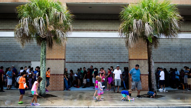 The line to enter Gulf Coast High School, a hurricane shelter, wrapped around the school on September 8, 2017.