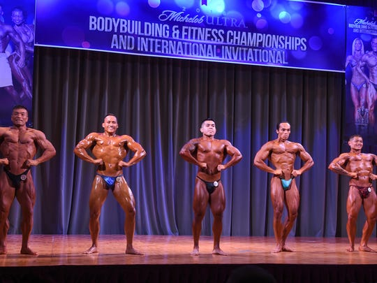 Mens' International Middleweight competitors display a front lateral spread pose during the 2016 Michelob Ultra Bodybuilding and Fitness Championships and International Invitational at LeoPalace Resort Guam in Yona on Nov. 12, 2016.
