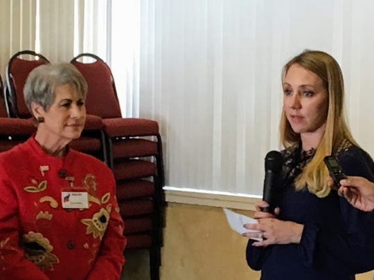 Federated Republican Women of Lincoln County's Ann Eby presents a check to Sarah Chavez to assist with the family's medical expenses.