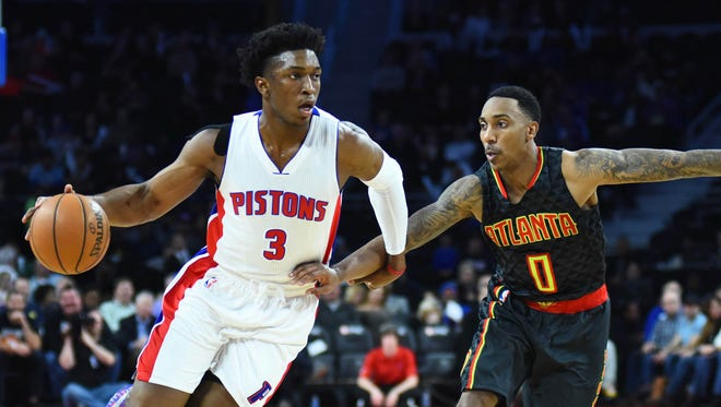 Hawks guard Jeff Teague (0) defends Pistons forward Stanley Johnson (3) during the second quarter at The Palace of Auburn Hills Wednesday.