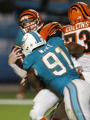 Andy Dalton is sacked by Miami's Cameron Wake for a