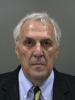 Noted Rochester criminal defense lawyer John Parrinello at noon Thursday turned himself in to the Gates Police Department and was charged with patronizing a prostitute.