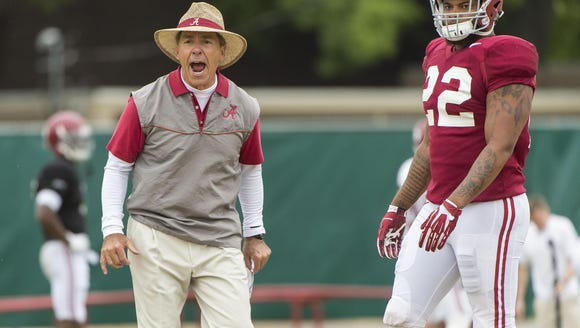 Alabama head football coach Nick Saban gets heated