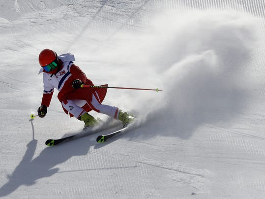 Kim Ryon Hyang of North Korea makes a turn during an inspection of the giant slalom course at the Yongpyong Alpine Center at the 2018 Winter Olympics in Pyeongchang, South Korea, Sunday, Feb. 11, 2018. (AP Photo/Michael Probst)