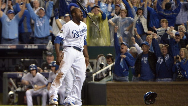 Lorenzo Cain scores from first base on a single by Eric Hosmer.
