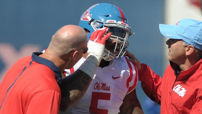 Ole Miss defensive tackle Robert Nkemdiche doesn't want to let a concussion in last Saturday's game end his getting snaps on offense.