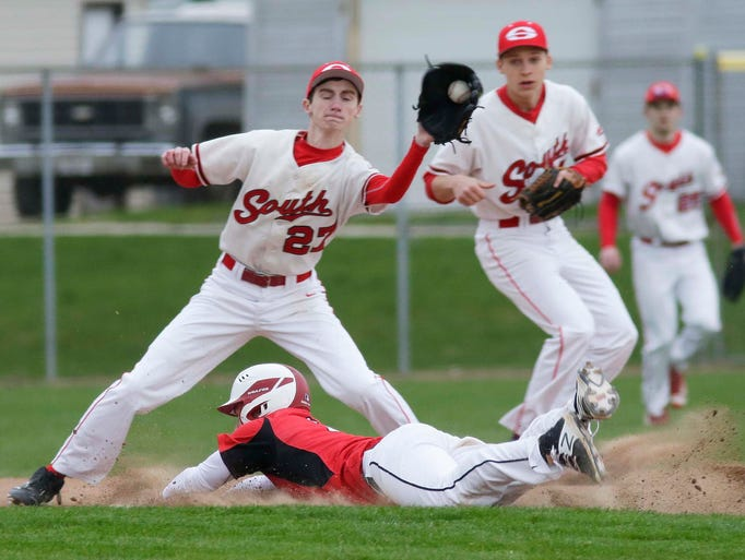 Manitowoc's Holden Kahlenberg (2) beats a potential