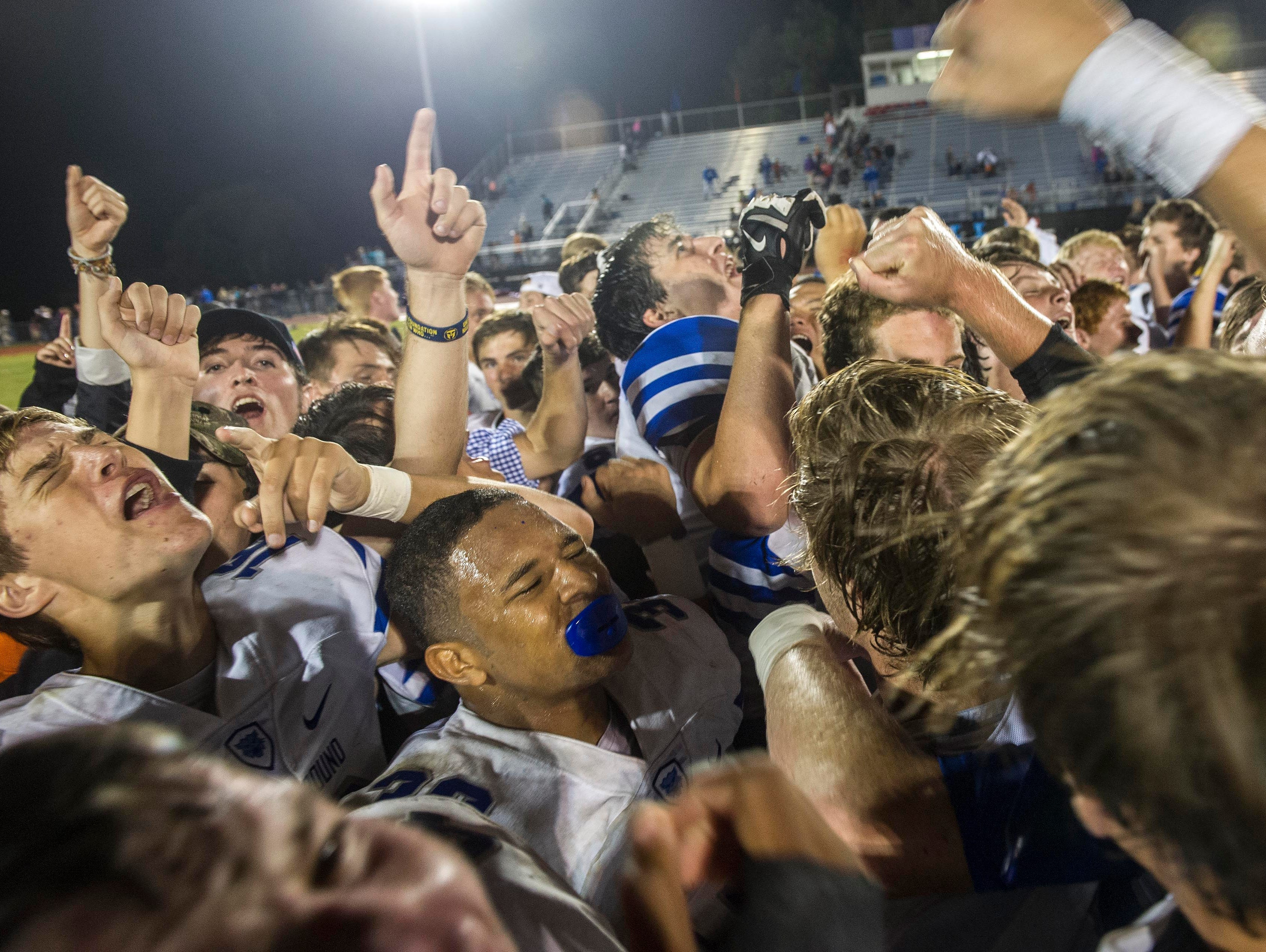 BGA celebrates after beating Page in overtime in Franklin.