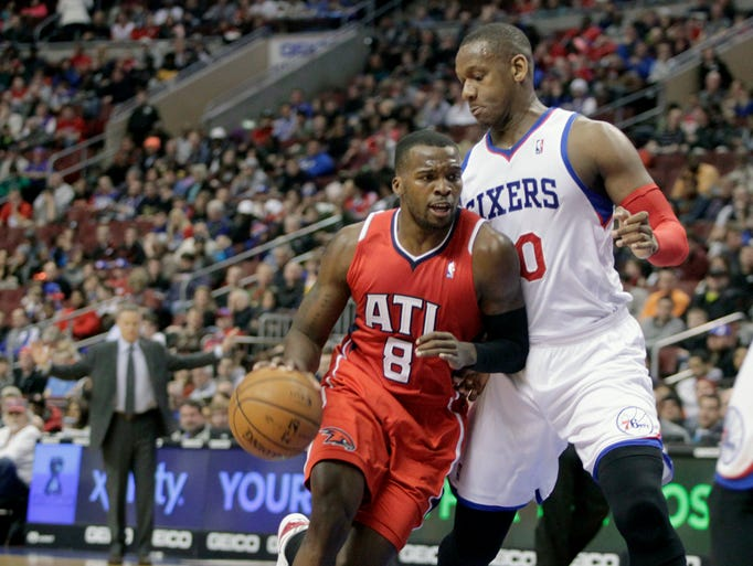 Atlanta Hawks' Shelvin Mack (8) drives to the basket against Philadelphia 76ers' Lavoy Allen in the first half of an NBA basketball game, Friday, Jan. 31, 2014, in Philadelphia. The Hawks won 125-99.