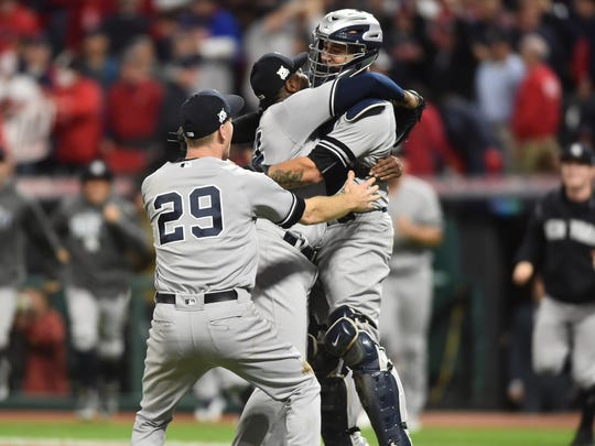 Oct 11, 2017; Cleveland, OH, USA; The New York Yankees celebrates after defeating the Cleveland Indians during game five of the 2017 ALDS playoff baseball series at Progressive Field.
