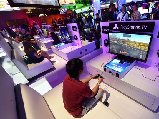 People test new Playstation consoles in 2014 at the