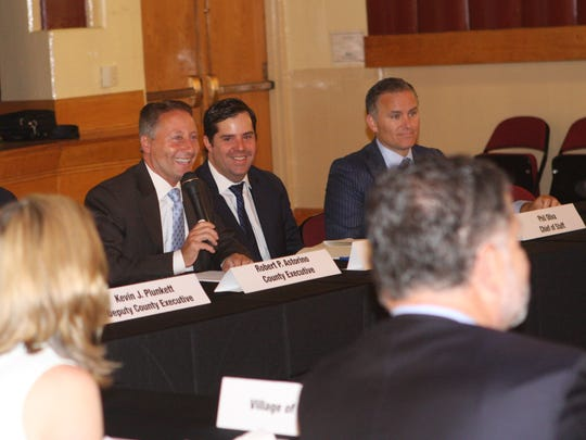 Westchester County Executive Rob Astorino leads a vote