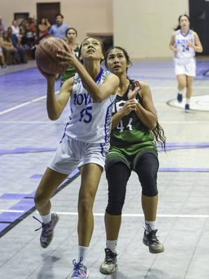 Notre Dame Royals guard Brianne Leon Guerrero scores a fast-break layup against the John F. Kennedy Islanders in an Independent Interscholastic Athletic Association of Guam Girls' Basketball League game at ND on Nov. 13. Leon Guerrero led all scores with 13 points.
