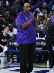 Ghost Ballers head coach George Gervin looks on during