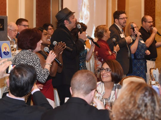 The County Players sing a song during United Way of