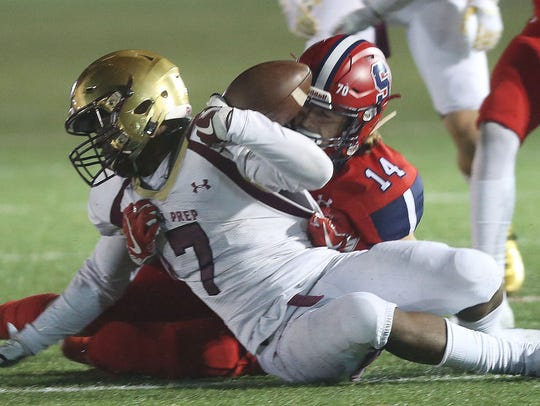 Ki'Shyne Shipmon is tackled during Iona Prep's 38-34 win during football action at Archbishop Stepinac High School in White Plains Oct. 28, 2017.