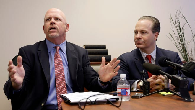 Attorney Terry Yates, left, answers a question as fellow attorney Jared Woodfill listens during a news conference Wednesday, Jan. 27, 2016, in Houston. Both attorneys represent David Daleiden and Sandra Merritt who are accused of using fake driver's licenses to infiltrate the nation's largest abortion provider in order to make videos that accused Planned Parenthood of illegally selling fetal tissue to researchers for profit.