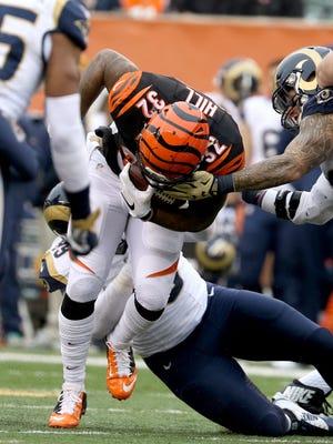 Cincinnati Bengals running back Jeremy Hill (32) tries to break through the Rams' defense at Paul Brown Stadium on Sunday  November 29,  2015. The Bengals won 31-7.