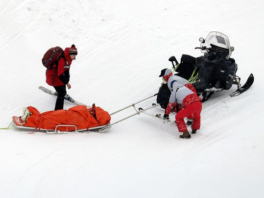 IndiaSherret, of Canada, is helped after crashing during the women's ski cross elimination round at Phoenix Snow Park at the 2018 Winter Olympics in Pyeongchang, South Korea, Friday, Feb. 23, 2018. (AP Photo/Kin Cheung)