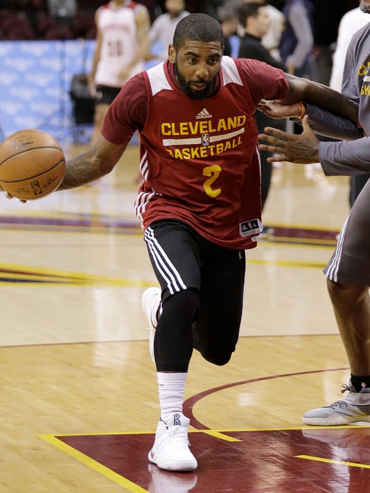 Cleveland Cavaliers  Kyrie Irving drives to the basket during practice for  Game 6 of the b569657cd