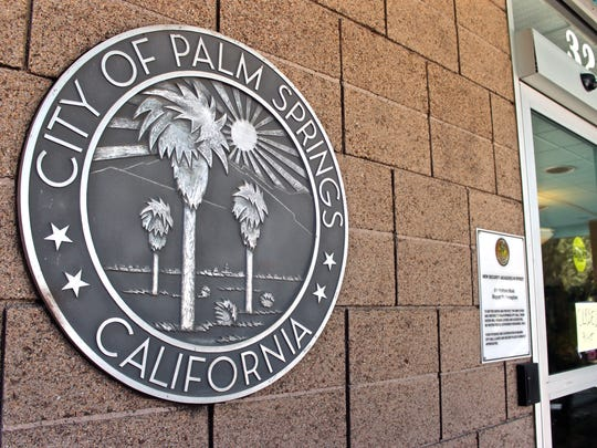 The Palm Springs city seal on a wall outside an entrance