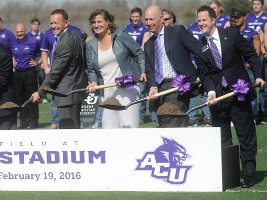 ACU President Phil Schubert, left, and ACU athletic director Lee De Leon, right, participate in the ceremonial groundbreaking for the school's on-campus football stadium, along with donors April and Mark Anthony. The field was named after the Anthonys, who donated $15 million to get the project started.