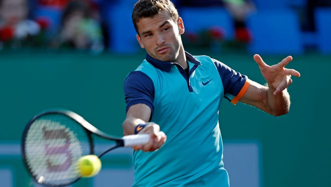 Grigor Dimitrov of Bulgaria returns the ball to Andrey Golubev of Kazakhistan during their first round match of the Istanbul Open.